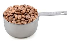 Pinto beans in an american cup measure Stock Photos