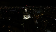 Stock Video Footage of Large office tower aerial view at night