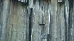 Tilt on rocky formation of hexagonal basalt Stock Footage