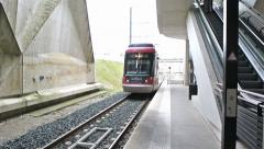 Train arriving in station platform Stock Footage