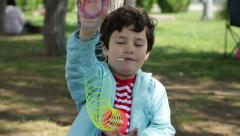Playing With Colorful Plastic Spring Toy Stock Footage
