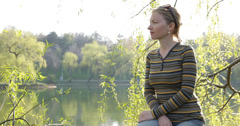 Ultra HD 4K UHD Young girl woman admire lake idyllic park nature meditative pond Stock Footage