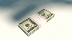 HD Packet of 100 dollar bills falling down Stock Footage