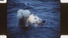 Stock Video Footage of Apollo 11 module after splashdown.  (Vintage 1960's 16mm film footage).