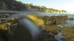 Medium shot of rocky beach shallows Stock Footage
