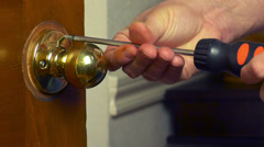 handyman removing the door knob 1080HD - stock footage