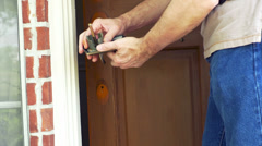 Handyman checking the fit of the new door knob 4k Stock Footage