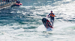 Man Doing Awesome Jet Ski Stunt Close Up - stock footage