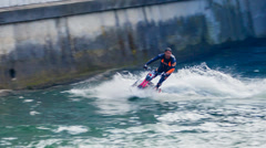 Scooter Jet Ski Stunt On Small River Ljubljanica Stock Footage
