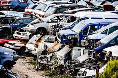 Old junk cars on junkyard Stock Photos