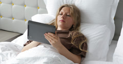 Ultra HD 4K Business woman work digital tablet lying bed luxury home surfing  Stock Footage