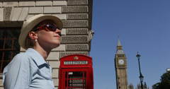 Ultra HD 4K Businesswoman relaxed Big Ben Tower british telephone London tourist Stock Footage