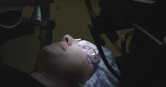 LASER EYE SURGERY STEP 11: Adjusting the lasik corneal flap Stock Footage