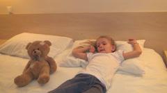 Child Watching TV in Bedroom, Sleepy Little Girl, Kid Lying on Bed, Children Stock Footage