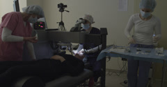 Ophthalmologic team during laser eye surgery Stock Footage