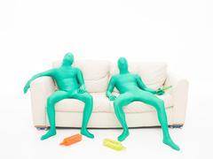 Tired green faceless men Stock Illustration
