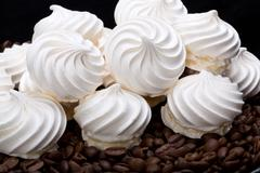french vanilla meringue cookies and  coffee beans - stock photo