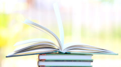 Stack of open book in wind. - stock footage