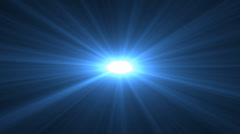 Blue lens flare rising sun style spinning star on black background cgi - stock footage