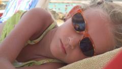 Child, Little Girl Sleeping on Beach, Sleepy Kid, Coastline, Children Lifestyle Stock Footage