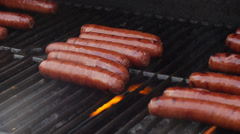 Cooking Hotdogs on the Grill 2 Stock Footage