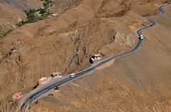curly road in the high atlas mountains in morocco - stock photo