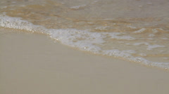 The beach and splashing waves in summer, close-up Stock Footage