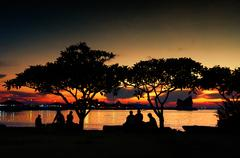 silhouette of people rest in park with sunset sk - stock photo