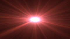 Red lens flare rising sun style spinning star on black background cgi Stock Footage