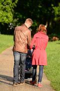 Young parents stroll through Stock Photos