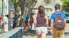 Tourists Walking in the Streets of St Georges, Bermuda Stock Footage