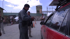 Vehicle searches at the Gates of Kabul by the Afghan National Police - stock footage