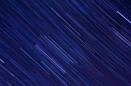 Stock Photo of Abstract background with Orion star trails in the night sky