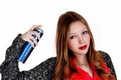 girl putting hairspray on. - stock photo