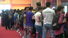 People standing in line, very long queues of young people waiting - stock footage