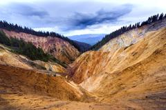 erosional view of ruginoasa pit from apuseni mountains, romania - stock photo