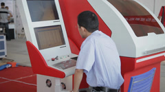View of worker operating machine, xi'an, china Stock Footage
