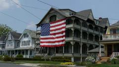 WS Patriotic United States Flag Victorian Homes Stock Footage