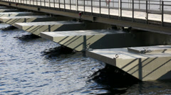 Pontoon bridge over water Stock Footage