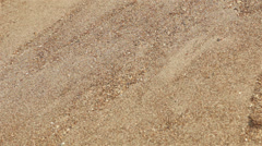 Sands on slope falling down. Close-up view background Stock Footage