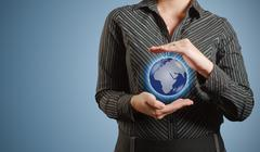 businesswoman holds or holding world earth in hand - stock illustration