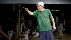 Man's emotion in garage Stock Footage