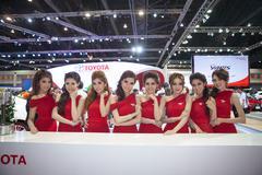 Unidentified females presenter at toyata booth Stock Photos