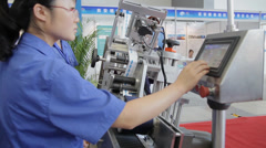 Iew of worker operating machine, Aug 29, 2013, Xi'an city,  china. Stock Footage