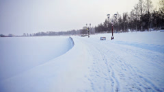 Frozen Onega lake embankment with footprints on snow Stock Footage