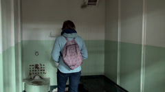 Tourist girl inside of the Alcatraz prison cell. Stock Footage