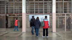 Tourists inside the cellhouse of Alcatraz Island Federal Penitentiary (Library). Stock Footage