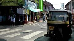 India Kerala Kochi Cochin City 033 downtown street scene with auto rickshaws Stock Footage