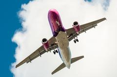 Big airplane in the sky - passenger airliner / aircraft Stock Photos