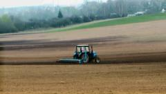 Traktor plows the land in spring Stock Footage